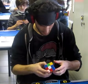 New-Rubiks-Cube-Solving-Record-While-BlindFolded-WCA-2012-Marcell-Endrey-300x287